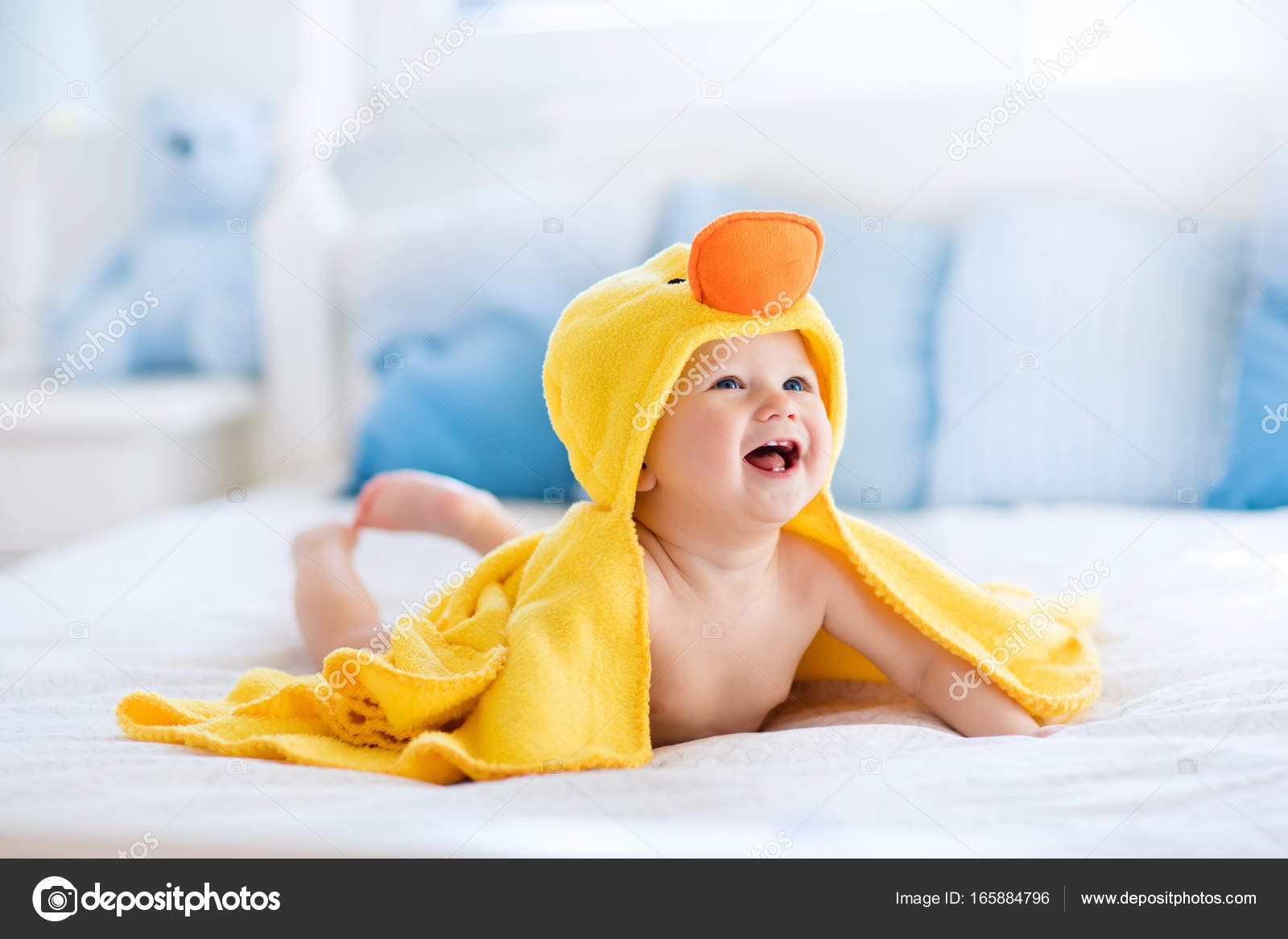 Cute baby after bath in yellow duck towel — Stock Photo © FamVeldman ...