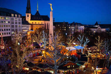 Christmas market. Winter fair with tree and lights.