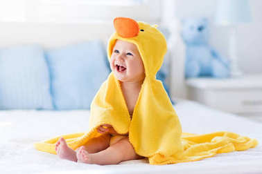 Cute baby after bath in yellow duck towel