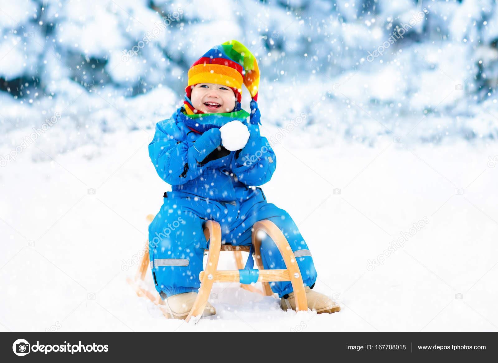 Christmas Vacation Sled.Boy On Sleigh Ride Child Sledding Kid With Sledge Stock