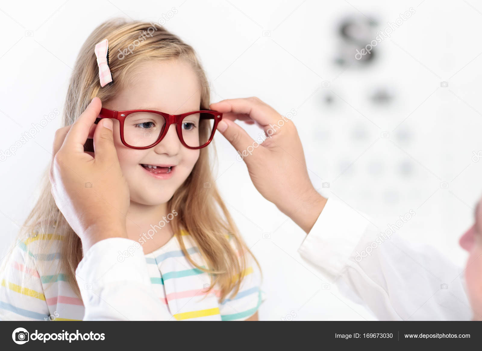 Child at eye sight test kid at optitian eyewear for kids stock child at eye sight test little kid selecting glasses at optician store eyesight measurement for school kids eye wear for children geenschuldenfo Images
