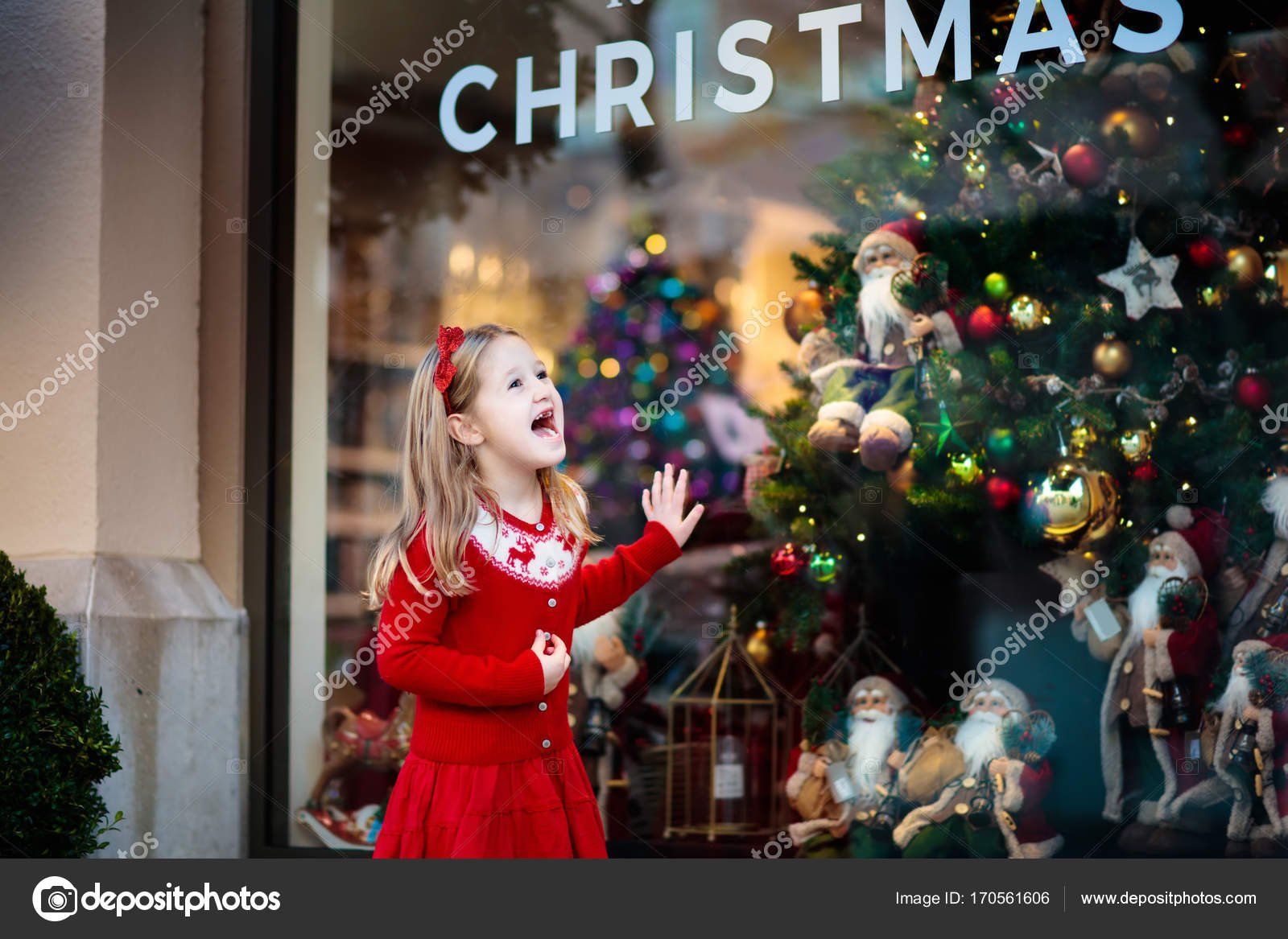 children buy xmas decoration and tree little girl at decorated shop window with lights and santa toys family buying christmas gifts winter holidays
