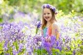 Fotografie Kids in bluebell garden