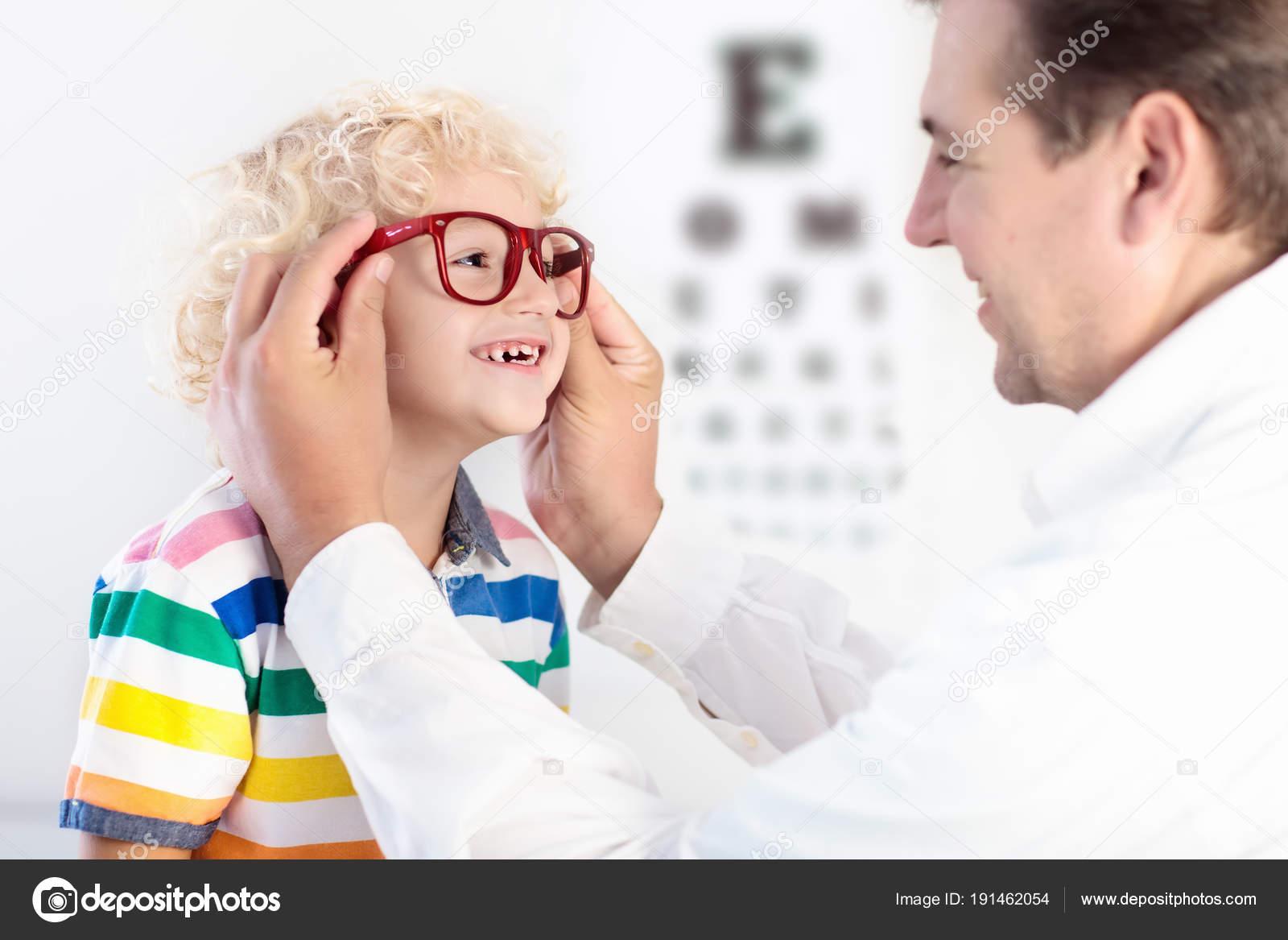 Child At Eye Sight Test Kid At Optitian Eyewear For Kids Stock