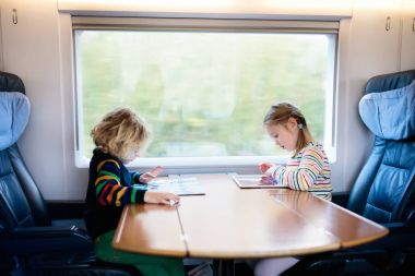 Kids travel by train. Railway trip with child.