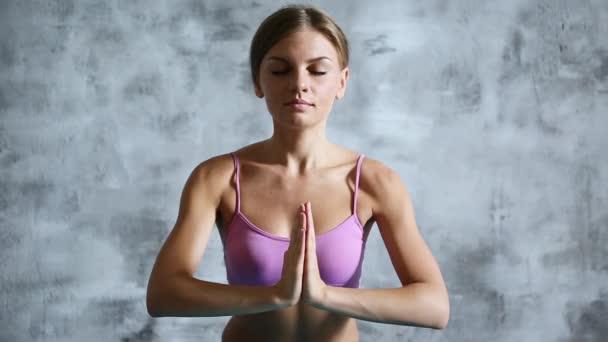 Beautiful woman doing yoga indoors.