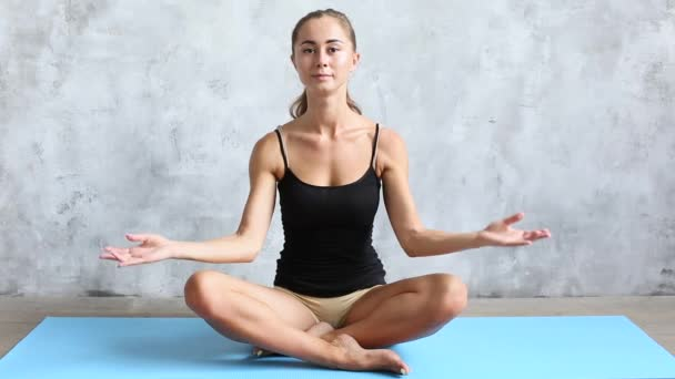Young beautiful woman in lotus position. Yoga and meditation.