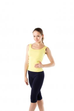Fitness woman in sport style standing. Isolated.
