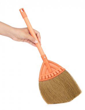 Hand holding Small broom isolated on white background