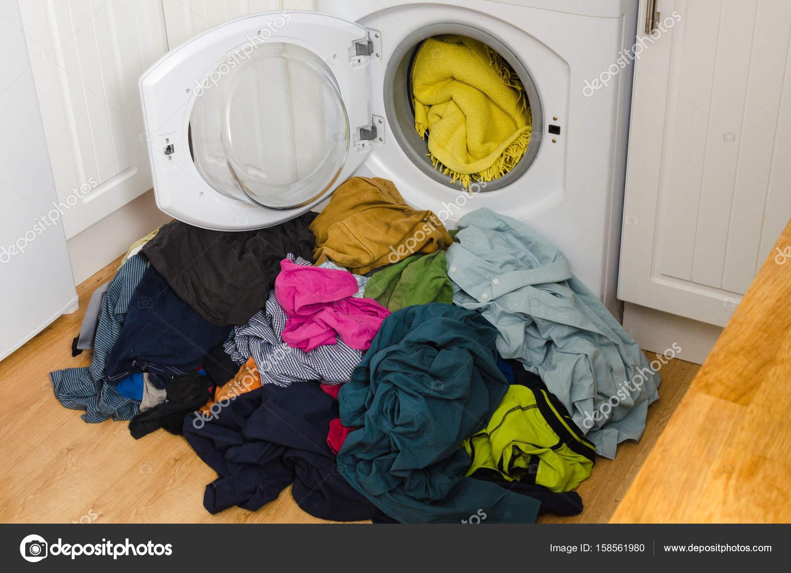 Colorful Pile Of Laundry At The Washing Machine Stock Photo