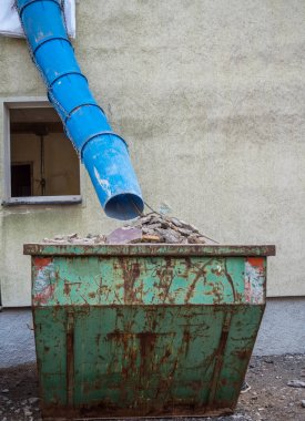 Rubble chute on a construction site with container