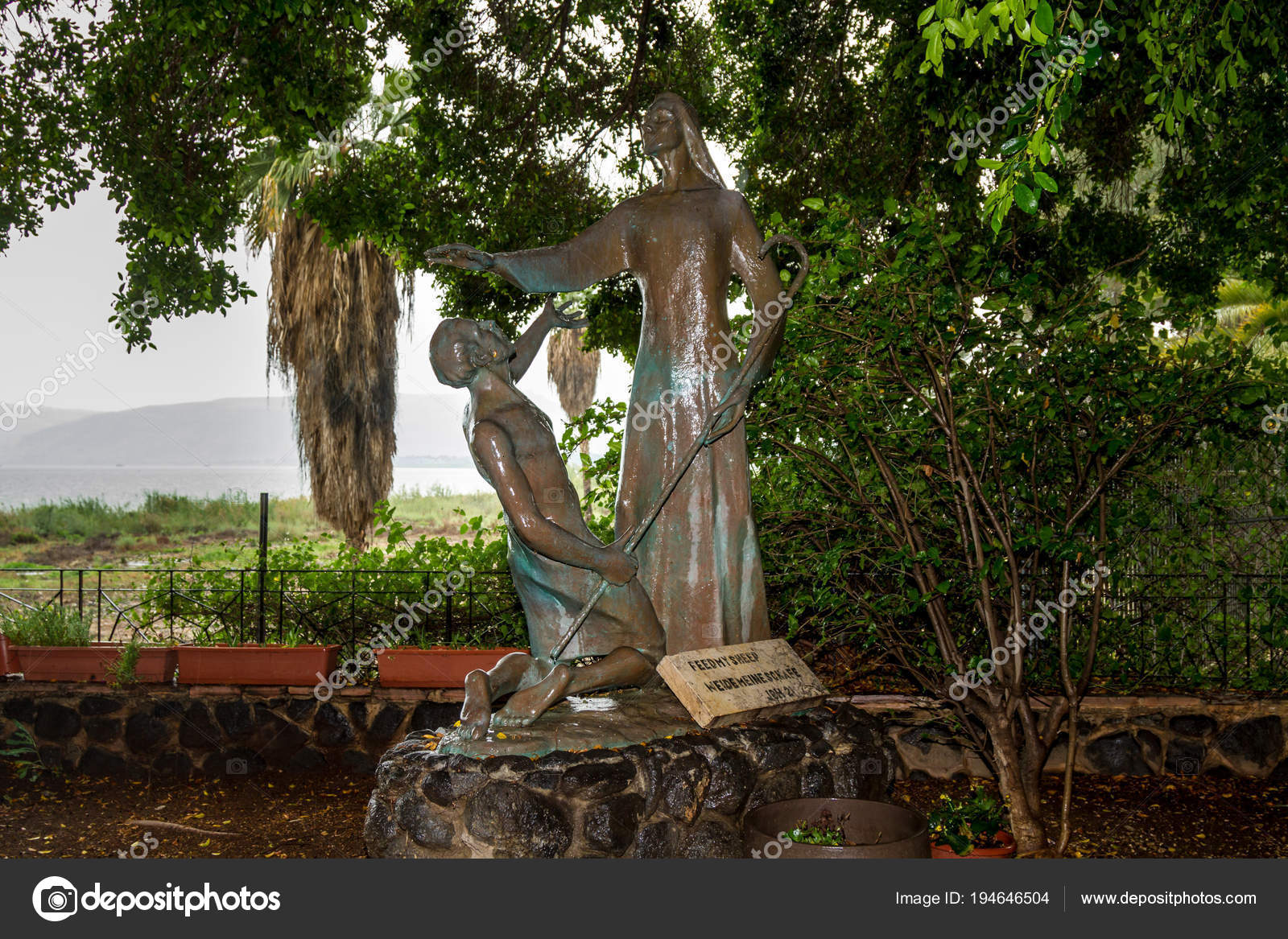 bronze sculpture of jesus and peter in the garden of church of the primacy of st peter on the coast of the sea of galilea tabgha israel photo by - Prim Garden