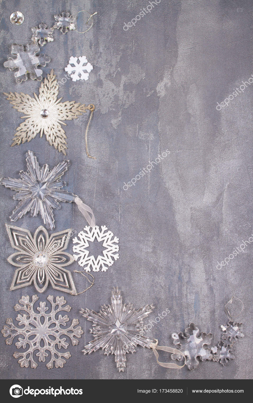 christmas and new year snowflakes border or frame on gray background winter holidays concept view from above top studio shot vertical photo by