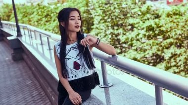 Gorgeous asian woman in fashion dress admiring the city view