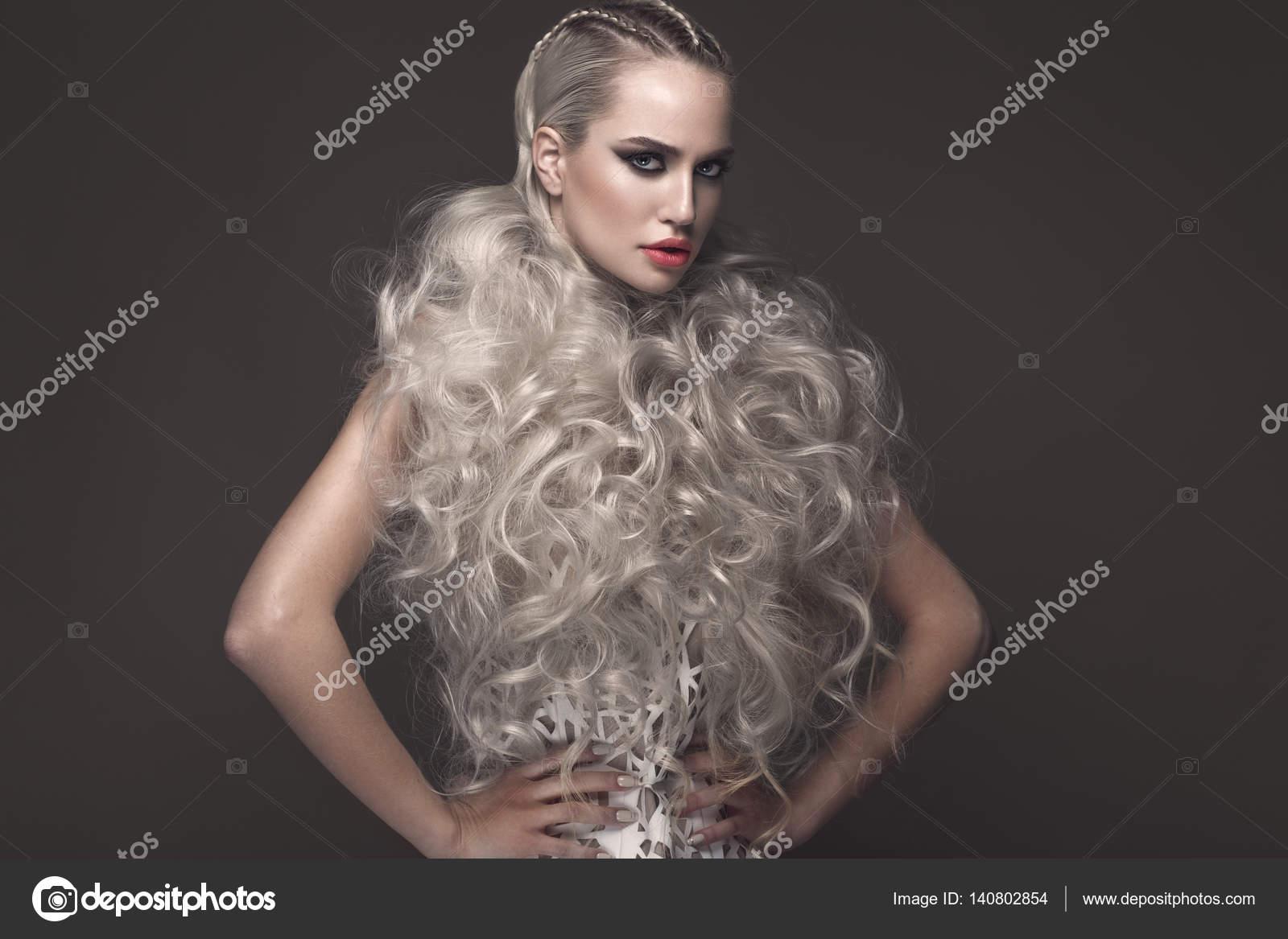 Beautiful girl in art dress with avant-garde hairstyles. Beauty face ...