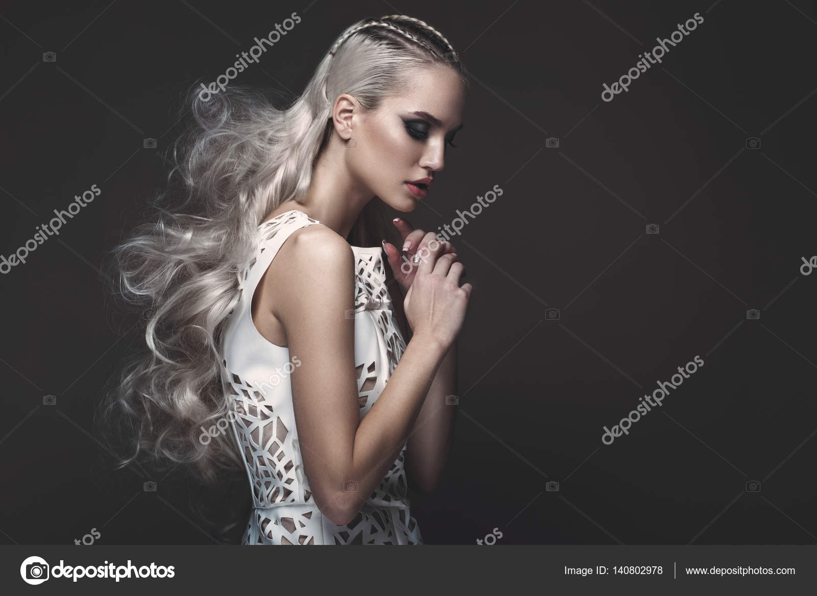 Beautiful girl in art dress with avant-garde hairstyles ...
