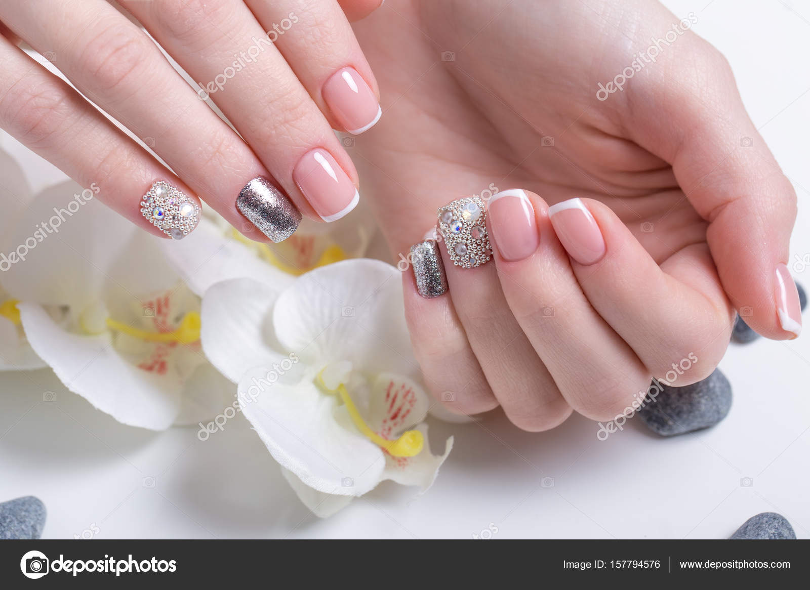 Beautiful Classic French Manicure With Rhinestones On Female Hand Close Up Picture Taken In The Studio Background Of Flowers Photo By Kobrin