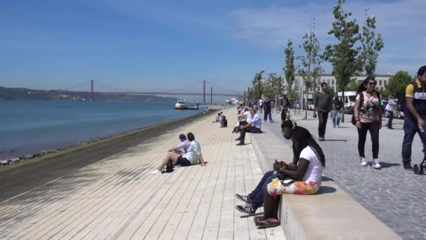 Lisbon, Portugal Bay, promenade, people walk, relax. Lisbon, Portugal, May 2017.