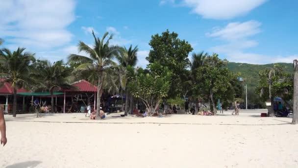 Pattaya, Koh Lan Island  Samae Beach, palm trees, beach, plants, people relax. Pattaya, Thailand 7.12.2017