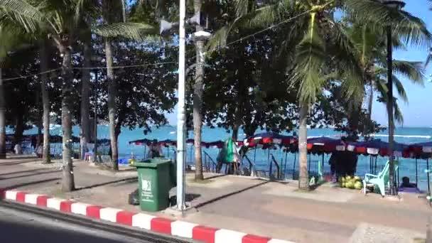 Pattaya, driving along the promenade, palm trees, sea, people. Pattaya, Thailand 7.12.2017