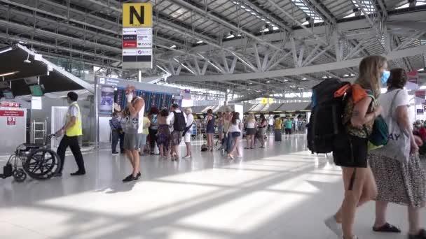 Bangkok Suvarnabhumi airport passengers inside the departure terminal, people in medical masks from coronavirus. Thailand Bangkok March 2020