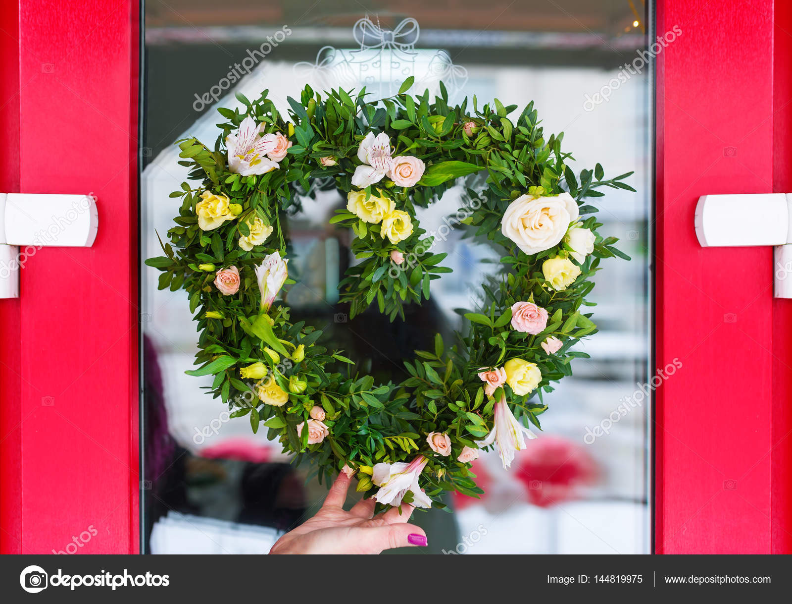 Woman Making Door Wreath With Spring Plants And Flowers Stock