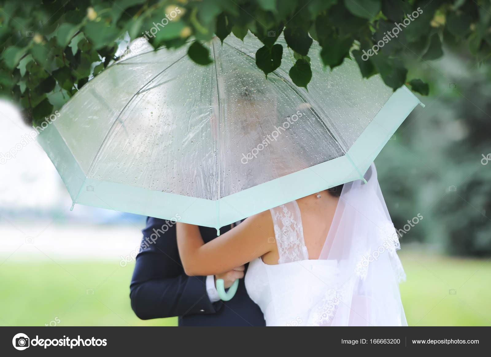 Romantic Beautiful Wedding Couple Hugging Under Elegant Umbrella Stock Photo C Avk78 166663200