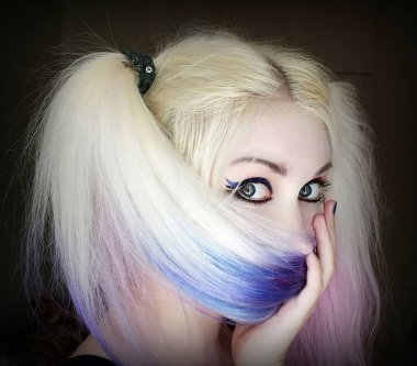 Girl hides her face behind hair