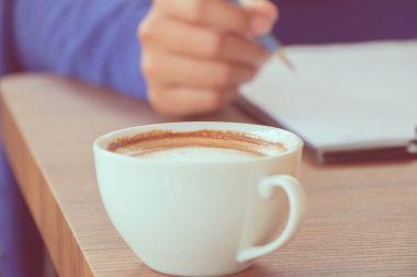 coffee with hand writing