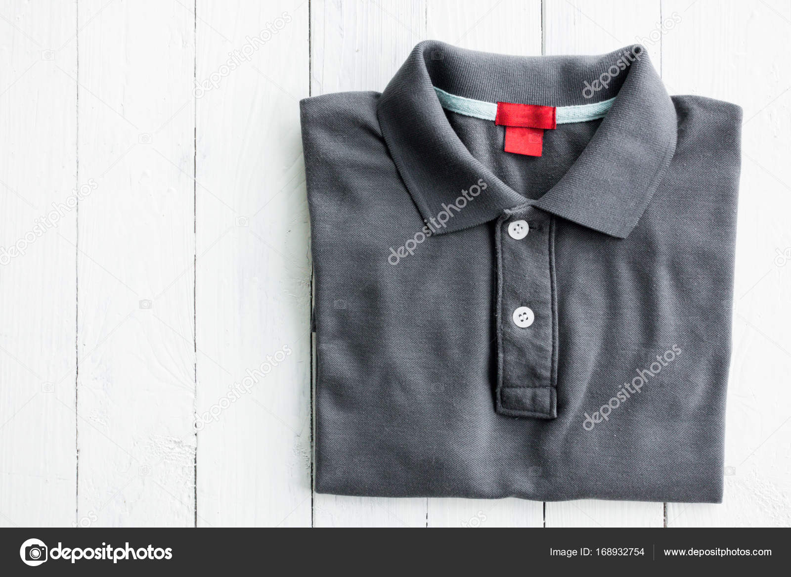 Polo Shirt Put On White Wooden Table Top Stock Photo
