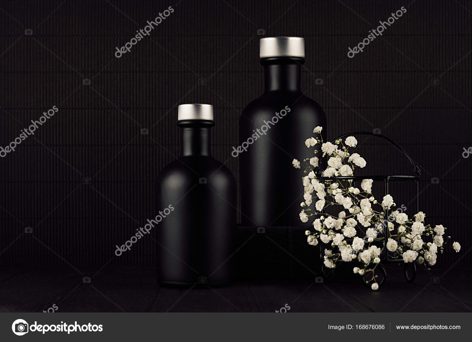 Noir Exquisite Home Decor With Blank Black Cosmetics Bottles White Small Flowers On Dark Wood