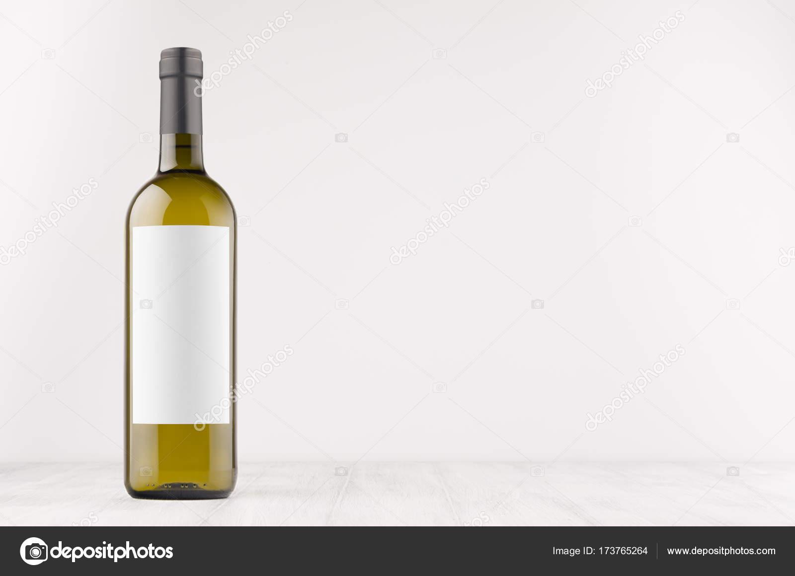 green wine bottle with blank white label on white wooden board mock
