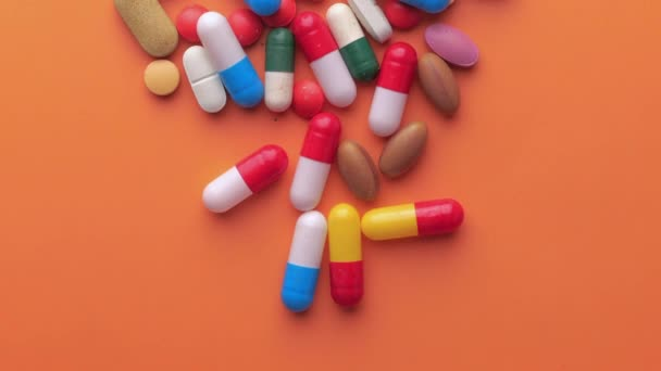top view of pills and capsule on pink background