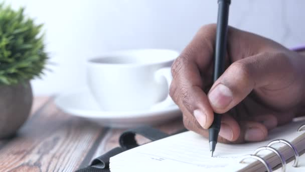 Close up of person hand writing on notepad