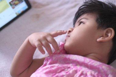 baby child watching cartoon on digital tablet