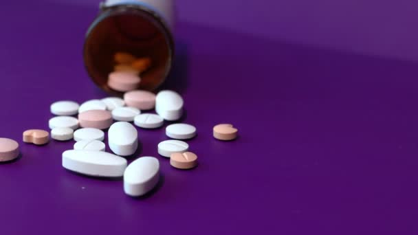 high angle view of colorful pills on color background