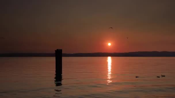 Lake Garda Sunset.  A timelapse recording of the sunset beside Sirmione on Lake Garda in Italy.