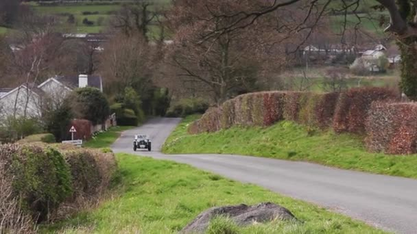A 1936 Riley 12/4 climbs Southwaite Hill in Cumbria, England.  The car is taking part in the 11th Flying Scotsman Rally, a free public-event.