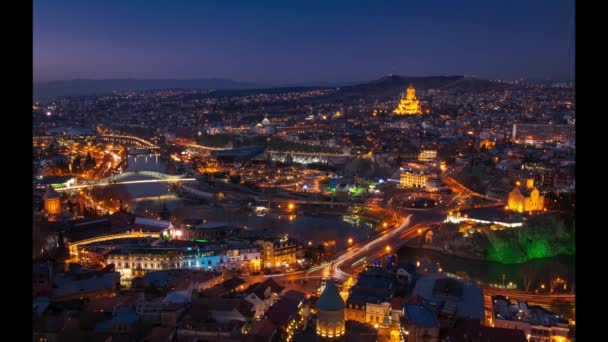 Panoramic view of Tbilisi city from NArikala fortress after the sunset during blue hour. Light trails of traffic and romantic Georgia concept. 2020