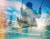 Fotografie Multiple exposure of kid on swing and pine forest with blue cloudscape