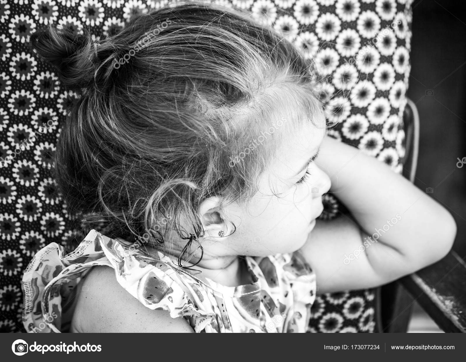 eda75ad1ab30 Cute little girl portrait wearing strawberry dress and looking aside,  monochrome– stock image