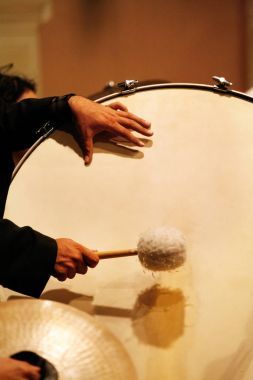 Musician hands playing drums during a concert