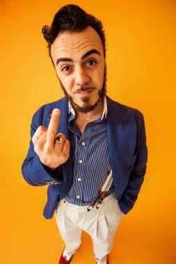 Funny portrait of man making middle finger gesture