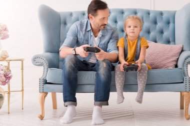 Pretty serious girl holding a game console