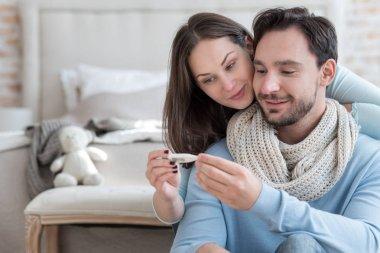Nice joyful couple recovering from an illness