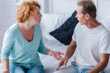 Choleric aged husband and wife quarreling