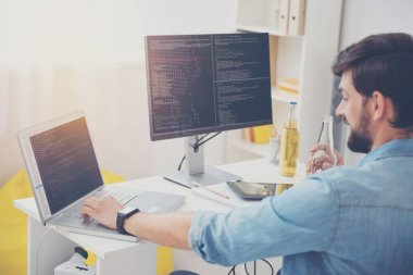 Young programmer working in an office