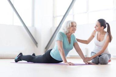 Positive optimistic woman enjoying her physical exercise