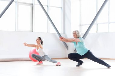 Delighted active women enjoying their fitness workout