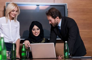 Positive delighted people using laptop